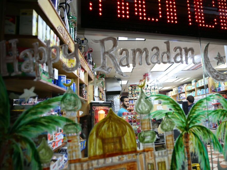 American Muslim shop owner waits for customers as he sells different types of lanterns for sale as part of preparations for the Holy Month of Ramadan in Bayridge neighborhood in Brooklyn borough of New York, United States on May 24, 2017.