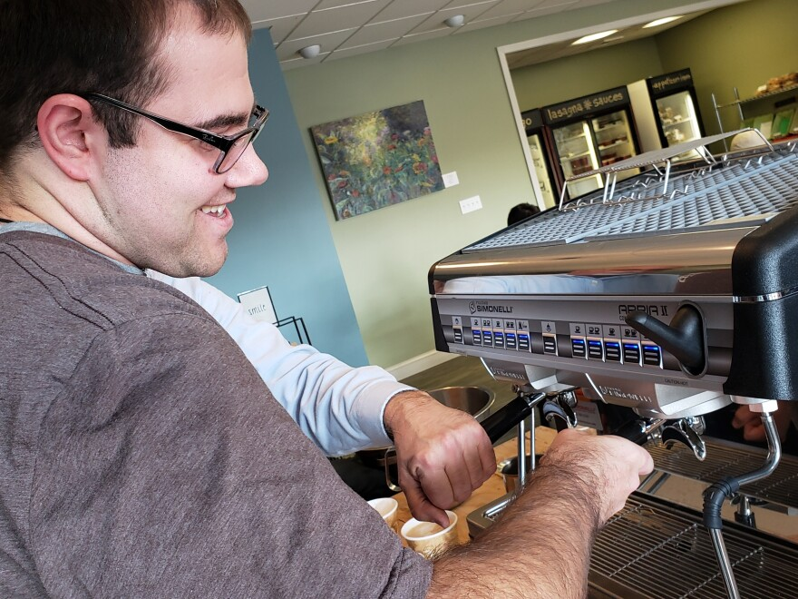 Nick Sinacori, 23, learns how to operate an espresso machine at BeanZ & Co. Cafe in Avon, Conn. The cafe was opened with the goal of hiring adults with intellectual disabilities.