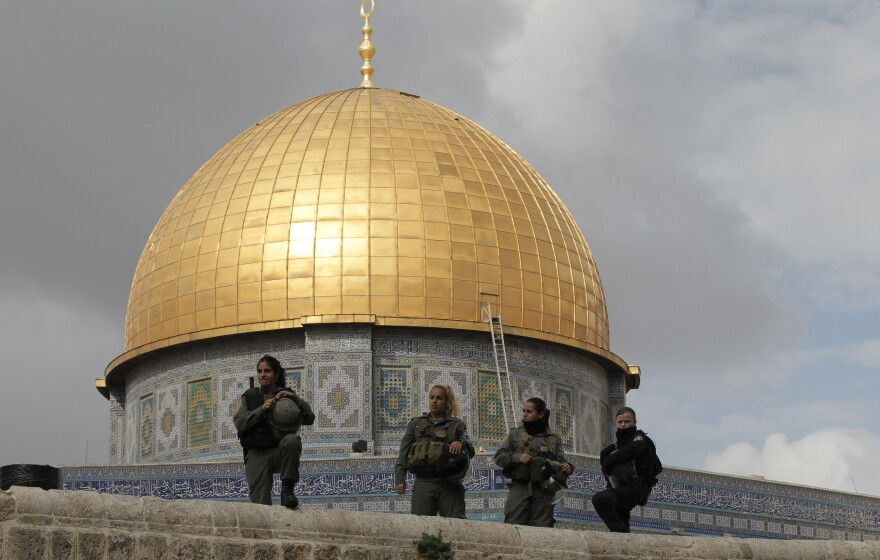 Israeli security forces stand guard near Jerusalem's Dome of the Rock mosque in the Haram al-Sharif compound, one of the holiest sites in Islam. It's also the most sacred place in Judaism. Israeli police clashed with stone-throwing Palestinians inside a nearby mosque on the compound as Jewish nationalists visited the site.