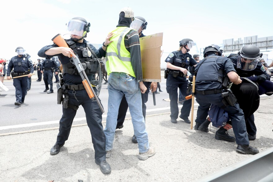 Protesters clash with police on I-35 on May 30 during a protest against racism and police violence.