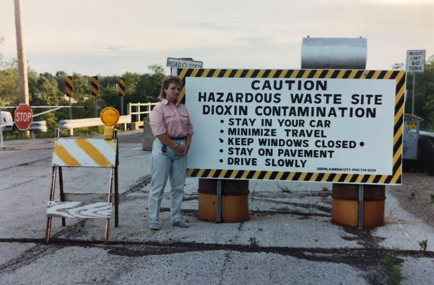 Marilyn Leistner, the last mayor of Times Beach, stands at a sign posted at the entrance to the town during the federal buyout. The federal Environmental Protection Agency announced the buyout in February 1983 after health officials declared the town unin