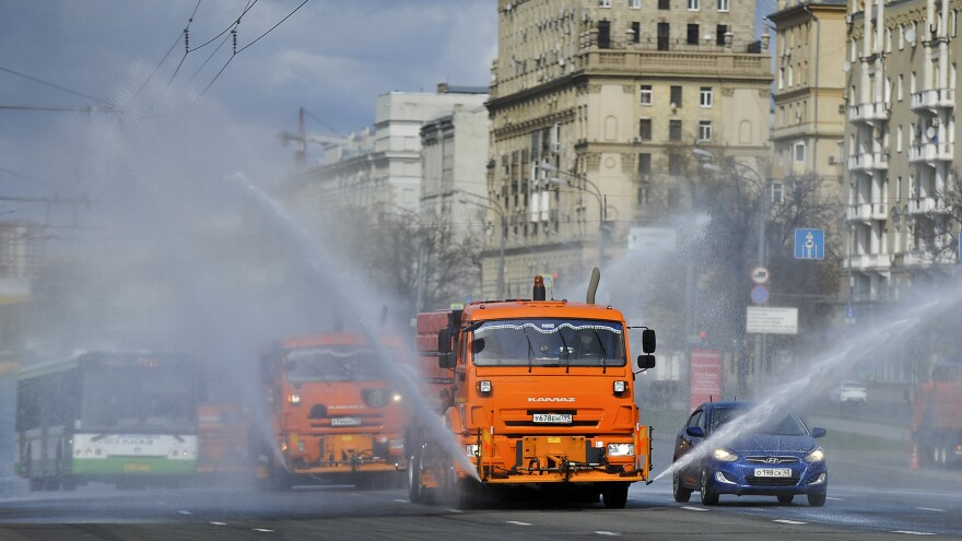 Municipal tankers spray disinfectant as a precaution against the coronavirus in Moscow on Sunday. Most of Russia's COVID-19 cases have been recorded in Moscow.