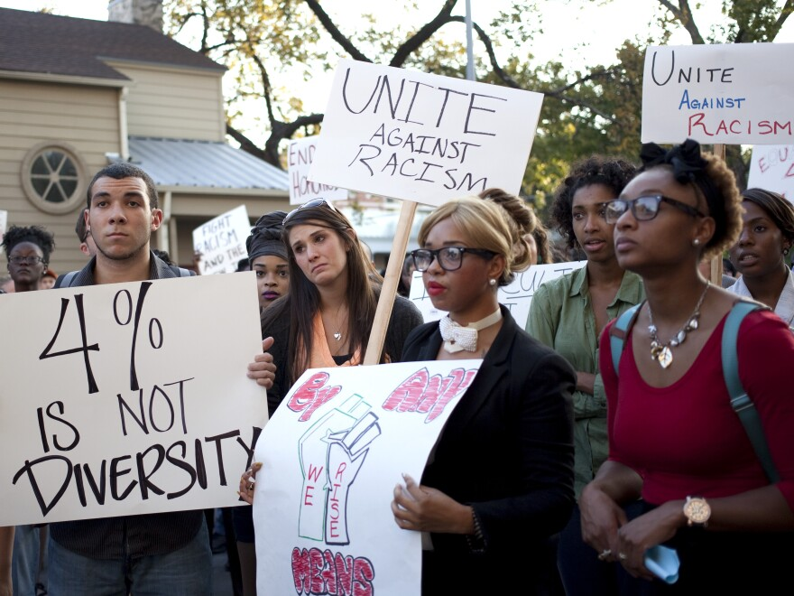 Students rally Oct. 3 in the wake of reports of water balloon attacks on minority students at the University of Texas at Austin. Campus police are investigating the incidents.
