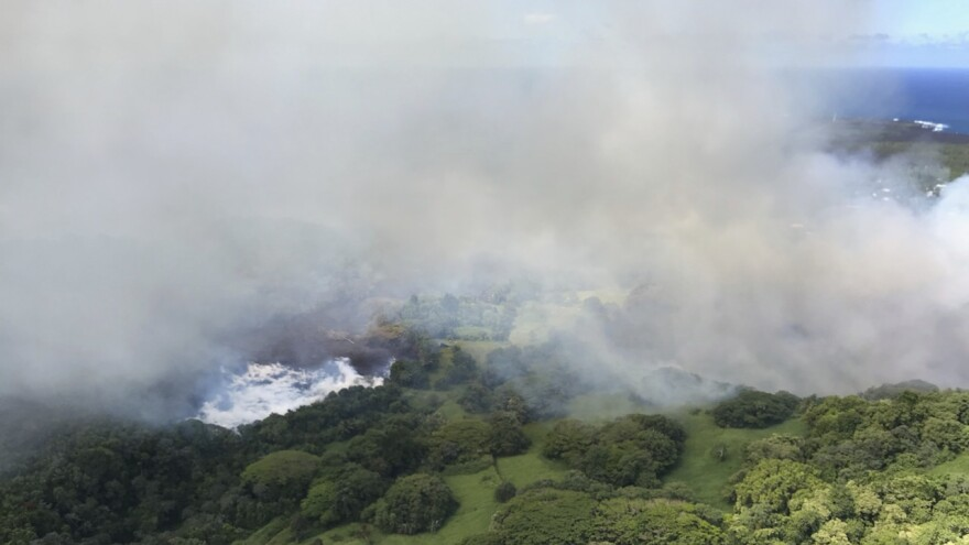 Lava steams after it hit Hawaii's Green Lake, which had been filled with water hours before, on Saturday.