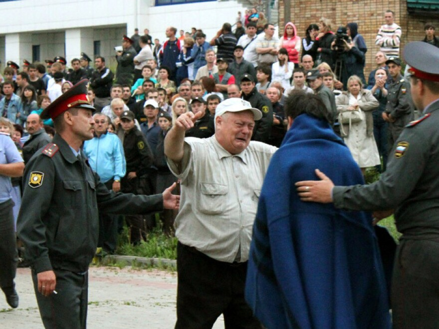A handout photo provided Monday by Russia's Republic of Tatarstan Emergencies Ministry shows a relative on Sunday greeting a survivor of the Bulgaria cruise ship that sank on the Volga River east of Moscow.
