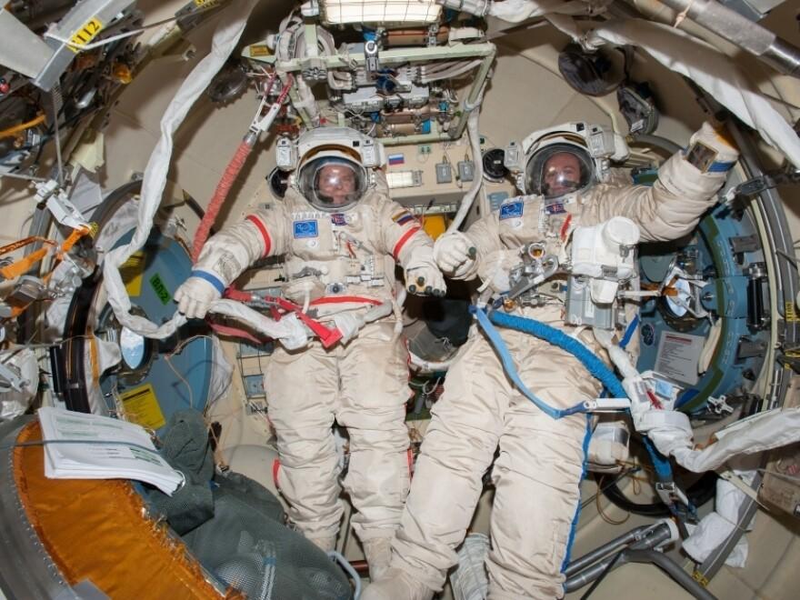 Commander Oleg Kotov (left) and Sergey Ryanzansky, preparing for a spacewalk aboard the ISS on Nov. 9.