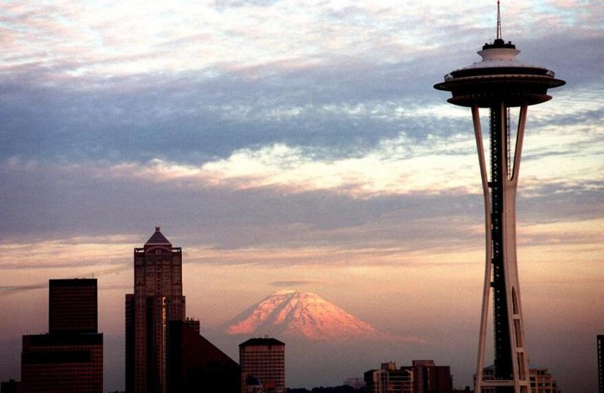 """The Seattle Space Needle's 50th anniversary is Saturday. Though the top of the Needle has been off-white for years, it's being painted its original color, """"galaxy gold,"""" for the anniversary."""