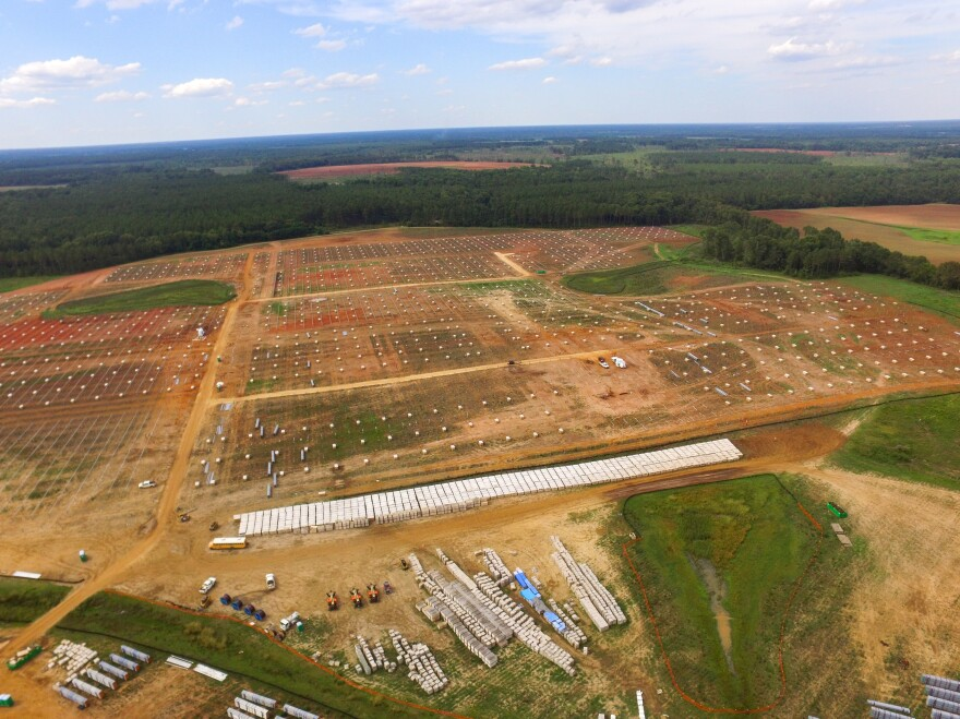 An aerial view of the construction site for Silicon Ranch's new solar farm. The company is building around existing ponds and wetlands and will keep a vegetative barrier so that the solar panels will not be visible from the road.