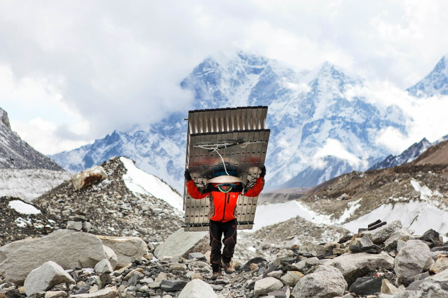 A Sherpa fetches ladders for climbers attempting to summit Mount Everest.