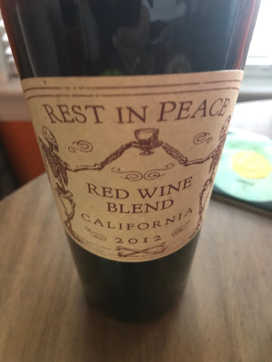 """Guests bring beverages and food that remind them of loved ones. Amy Pickard provides the """"death wine."""""""