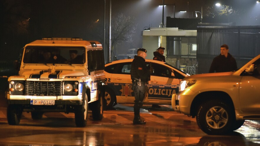 Police block off the area around the U.S. Embassy in Montenegro's capital, Podgorica. An unknown assailant hurled a hand grenade toward the embassy at around midnight local time on Thursday and then killed himself with another explosive device.