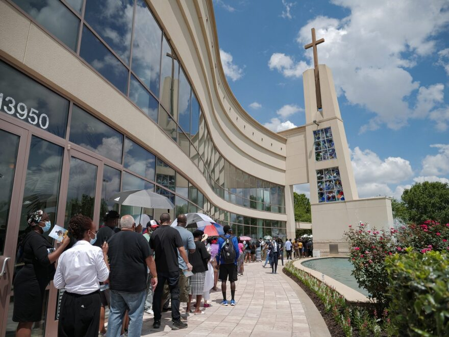 Mourners attend George Floyd's memorial in Houston, on Monday, June 8, 2020.