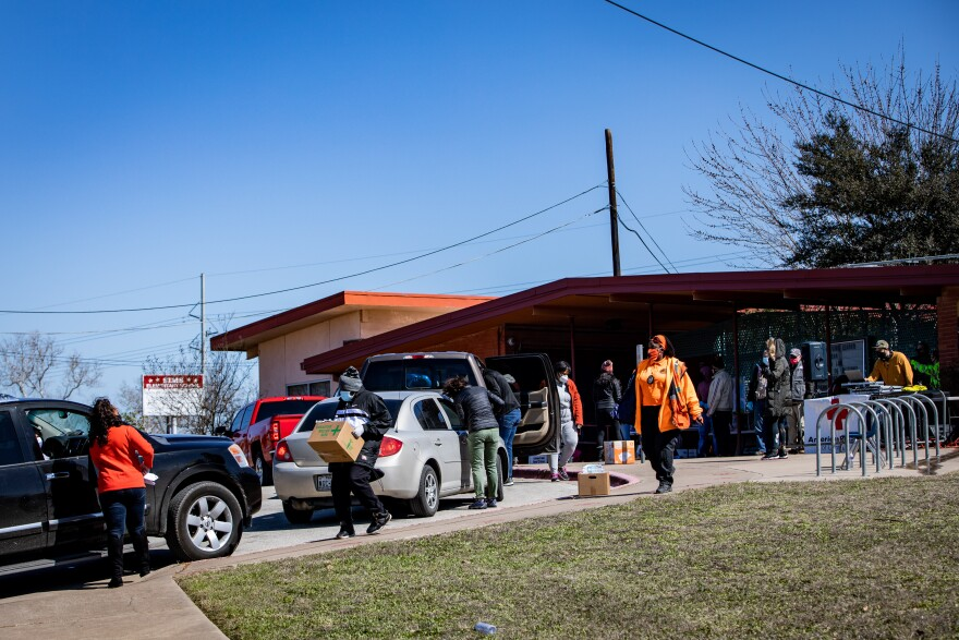 The Black Leaders Collective and other organizations distribute food and supplies at the former Sims Elementary School on Saturday.