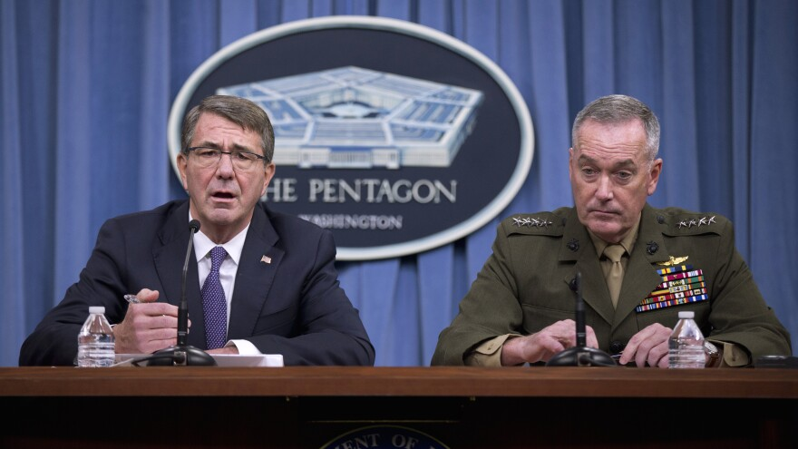 Defense Secretary Ash Carter (left) and Joint Chiefs Chairman Gen. Joseph Dunford, speak at the Pentagon on Friday. They announced that U.S. forces killed a senior Islamic State leader in an airstrike.