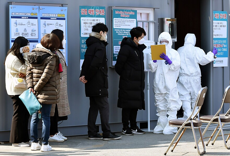 People suspected of being infected with the new coronavirus wait for diagnostic tests at a medical center in Daegu, South Korea.