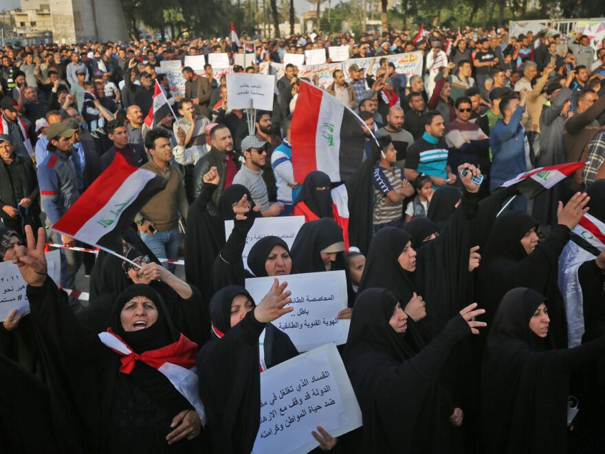 Iraqi supporters of Muqtada al-Sadr shout slogans and wave national flags as they demonstrate in Baghdad against corruption in the Iraqi government on March 2.