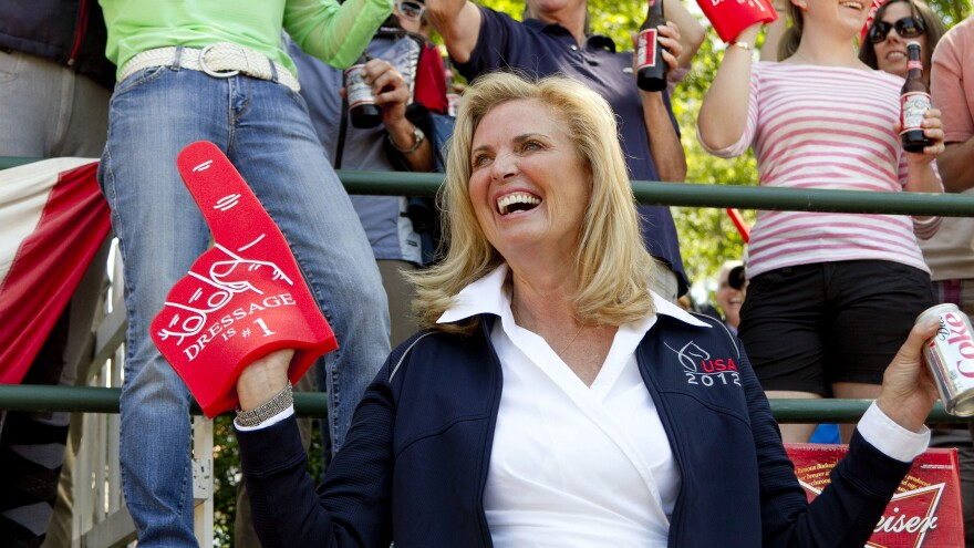 """Ann Romney, wife of Republican presidential candidate Mitt Romney, wears a """"Dressage is no. 1"""" foam finger at a competition on Saturday. Romney's horse, Rafalca, qualified for the 2012 Olympic dressage team."""