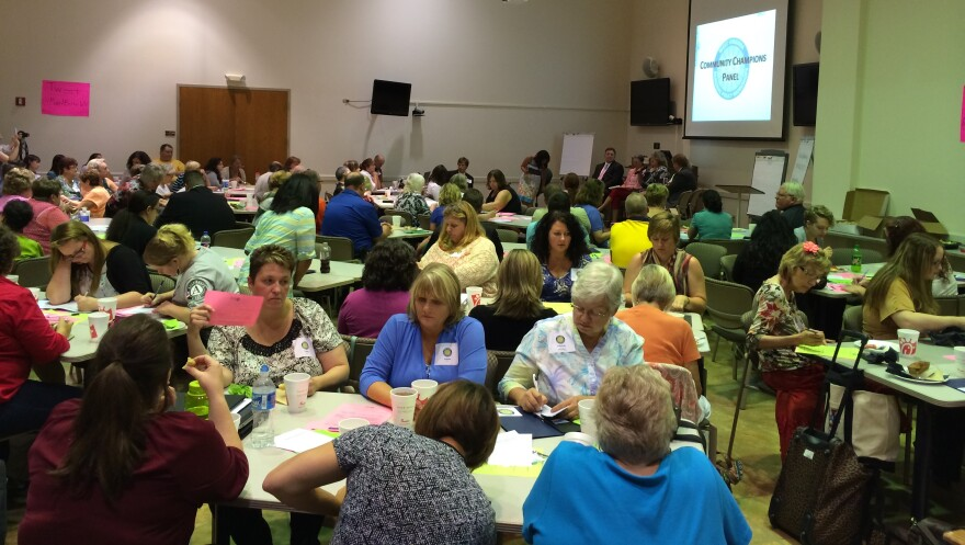 A roomful of citizens gathers at the Caperton Center in Clarksburg to discuss policy priorities.