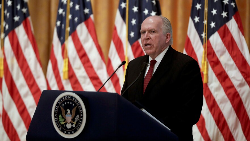 John Brennan is shown speaking here at the Richard Nixon Presidential Library in Yorba Linda, Calif., in 2016, when he was serving as CIA director. Brennan says he is considering a legal challenge to President Trump's decision to revoke his security clearance.