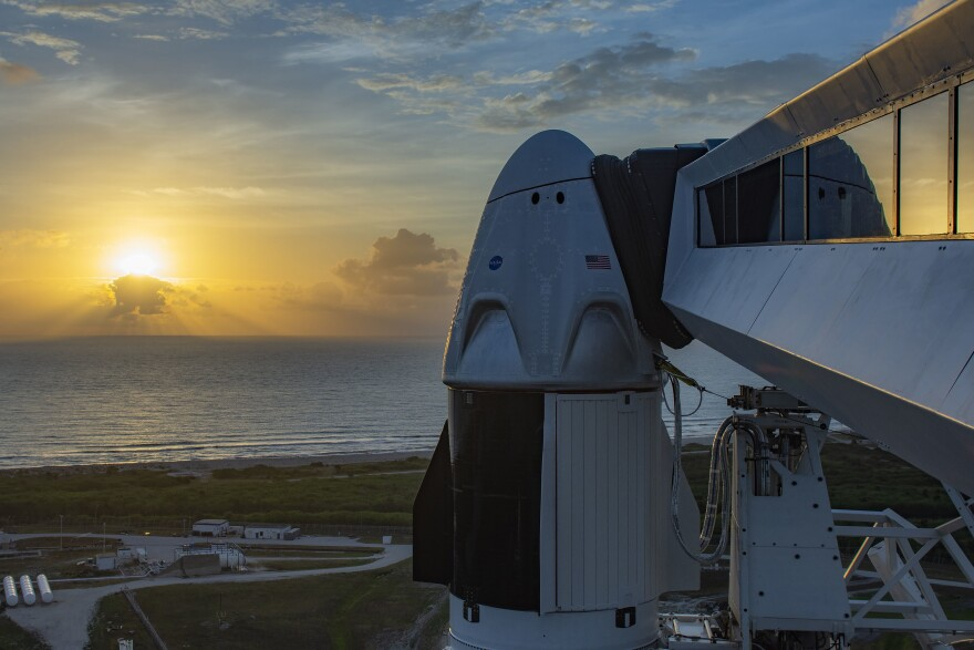 The Dragon spacecraft atop a Falcon 9 rocket at NASA's Kennedy Space Center. Astronauts Bob Behnken and Doug Hurley had been set to launch on Wednesday afternoon, but the weather did not cooperate.