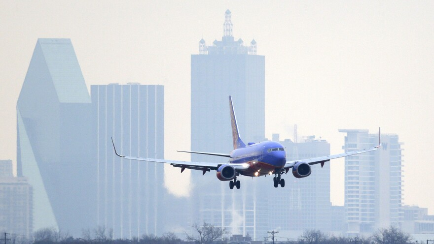 A Southwest Airlines jet plane lines up for a landing at Love Field in Dallas.