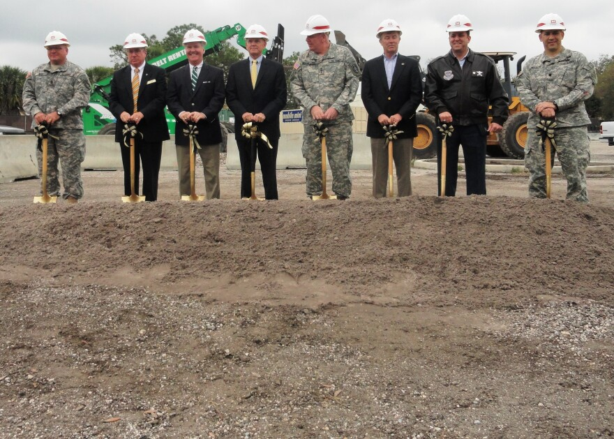 Left to right: Command Sgt. Maj. David Betz; JSOU President Brian Maher: Tampa Mayor Bob Buckhorn; retired Army Gen. Doug Brown; Army Lt. Gen. John Mulholland; Retired Vice Adm. Joe Maguire; Air Force Col. Andre Briere; Army Lt. Col. Thomas Nelson.
