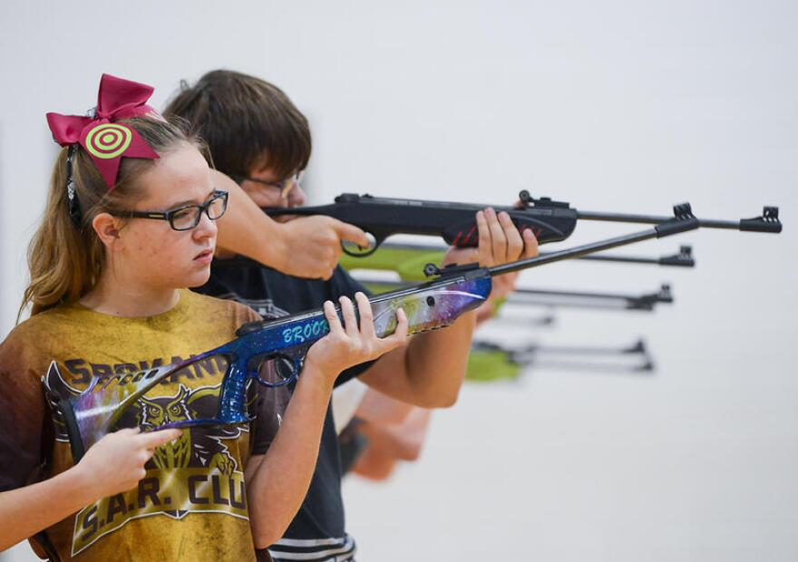 Brooklyn Grant, 13, from Spokane, Missouri, looks down range at the Student Air Rifle Program Tournament at Clever High School on Nov. 14, 2019. Brooklyn took first place in the middle school individuals girls category.
