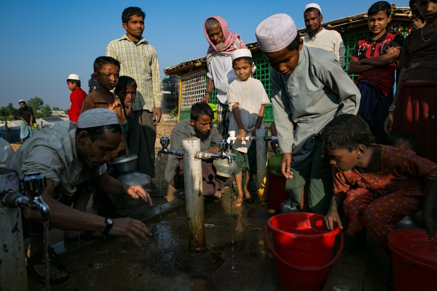 Refugees collect water and wash before prayers.