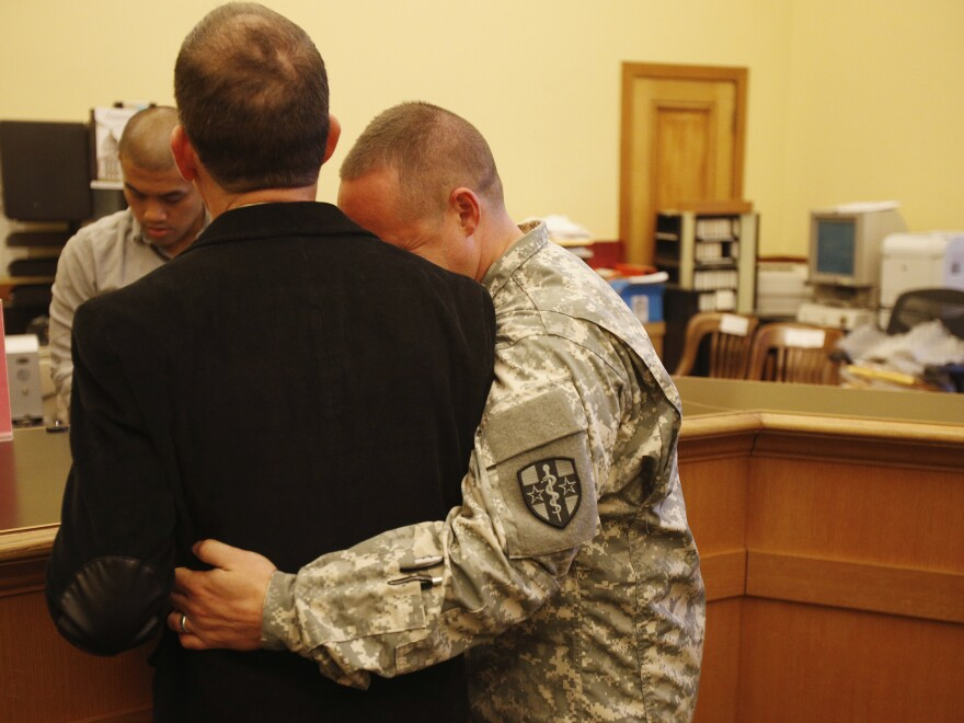 U.S. Army Captain Michael Potoczniak (right) embraced his partner of 10 years Todd Saunders as they obtained their marriage license at City Hall in San Francisco on Saturday.