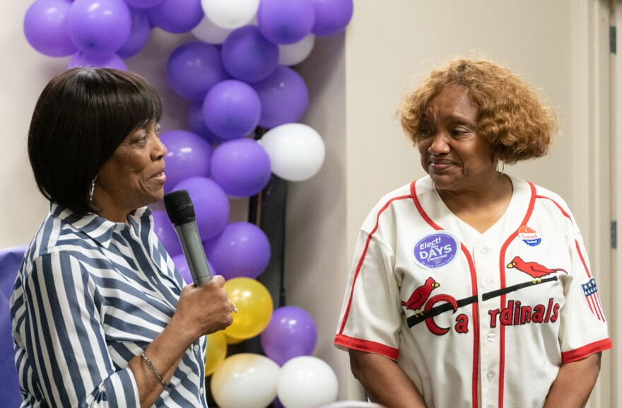 Former St. Louis County Councilwoman Hazel Erby congratulates Rita Days, a former state lawmaker who will fill Erby's 1st District seat on the council. Aug. 6, 2019