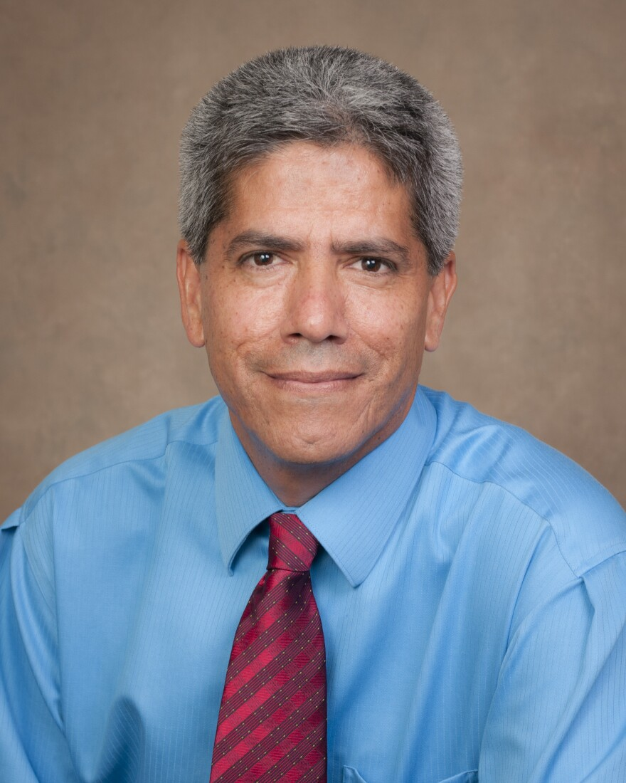 a photo of Manuel Gordillo in blue shirt and red tie