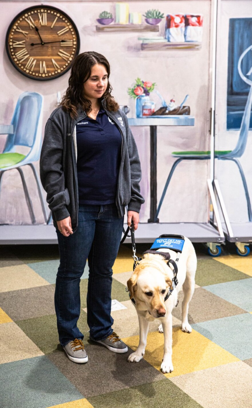 Katie McCoy and her guide dog, Bristol.