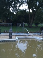DeeDee Brickner recently upgraded the pool liner at this one-story ranch she owns and rents to tenants. With this latest flood, she's ready to hand over the keys to the city.
