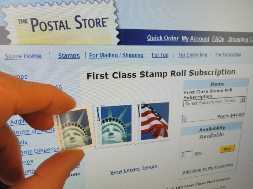 A man holds up a first class 44-cent stamp. The U.S. post office had egg on its face Friday after realizing that a stamp showing the Statue of Liberty in close up was not taken in New York's harbor, but Las Vegas.
