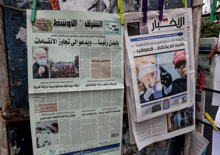 This picture taken on November 8, 2020 shows a view of international Arabic newspaper Asharq Al-Awsat (L) and Lebanese newspaper al-Akhbar (R) along a stand in Lebanon's capital Beirut, with headlines featuring the 2020 US general election results. (ANWAR AMRO/AFP via Getty Images)