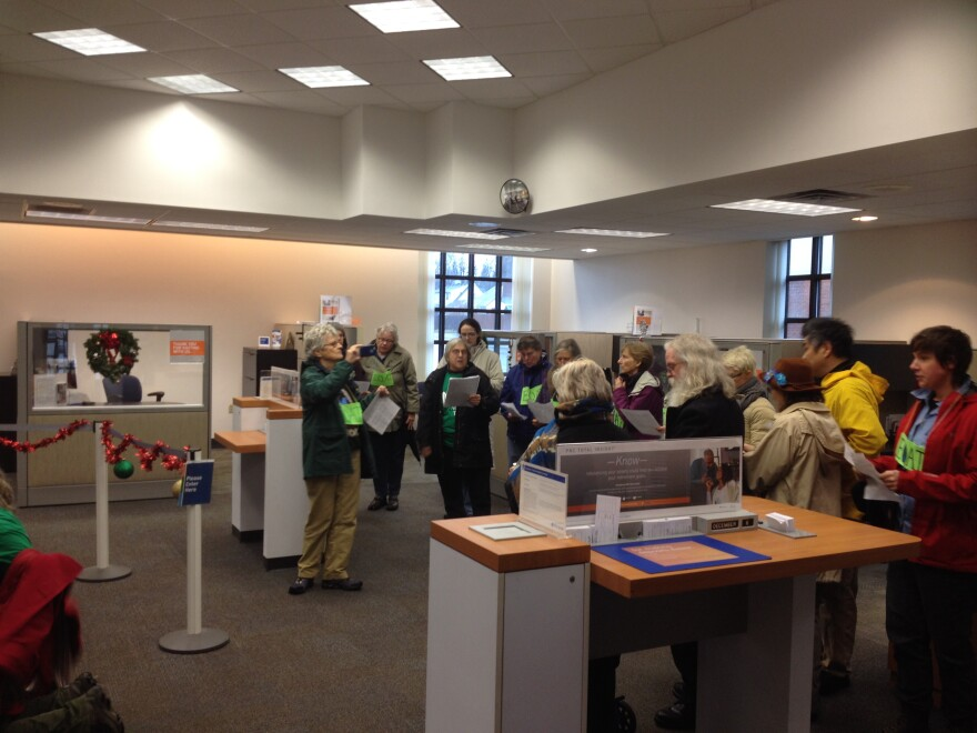 PNC Bank called police after protesters went inside, singing. quakers