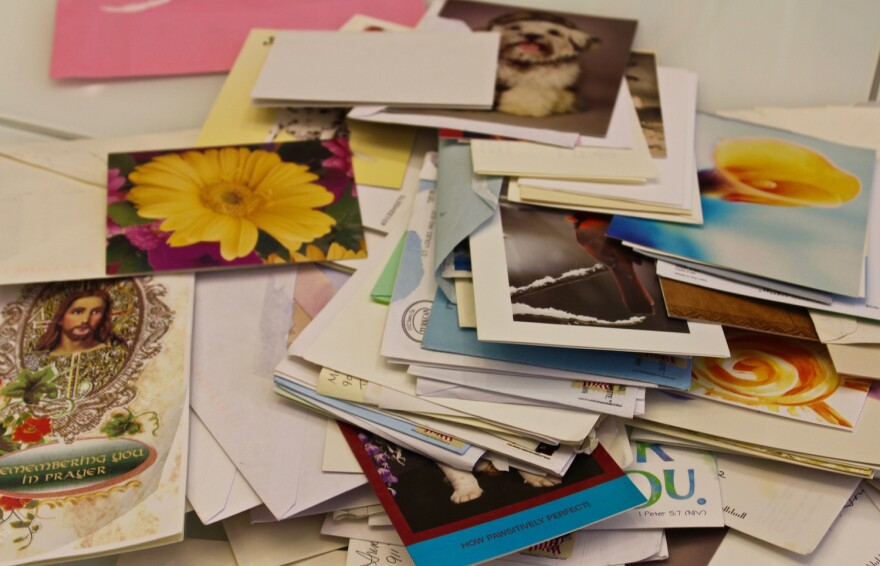 City attorney John Hessel kept all of the cards and letters well-wishers sent him after the shooting.