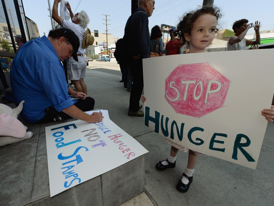 Gracie Shannon-Sanborn, 5, holds a sign as she joins her father Allen Sanborn (L) and members of Progressive Democrats of America at a rally in front of Rep. Henry Waxman's office on June 17, 2013 in Los Angeles, Calif. The protestors asked the congressman to vote against a House farm bill, which was defeated Thursday.