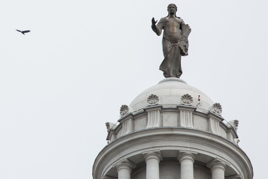 A bald eagle flies over the Missouri State Capitol Building during the Missouri Bicentennial inauguration ceremony on Monday in Jefferson City.