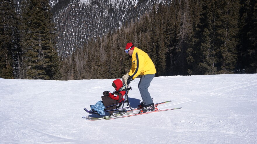 Tilghman Logan and his instructor, Craig Stagg, do some practice turns using sit skis. Some ski resorts have created opportunities for people with disabilities to participate in snow sports.