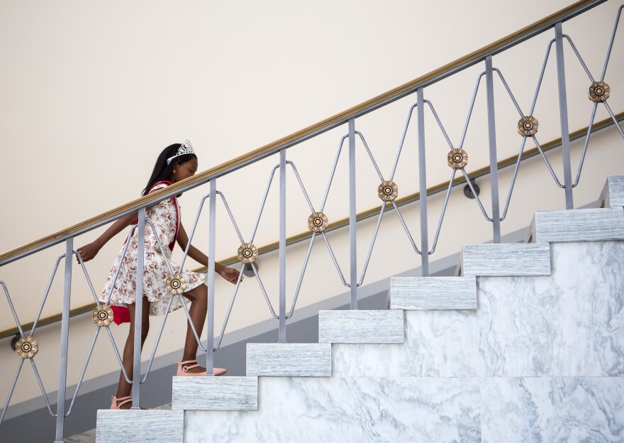 Tymia takes the stairs in the Rayburn House Office Building on her way to meet with Sanford. By the end of the day, she was using a wheelchair.