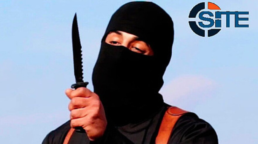"""A U.S. drone aircraft used a Hellfire missile to hit a target that was believed to include Mohammed Emwazi, known as """"Jihadi John,"""" seen here in an image made from a militant video that has been verified by SITE Intel Group."""