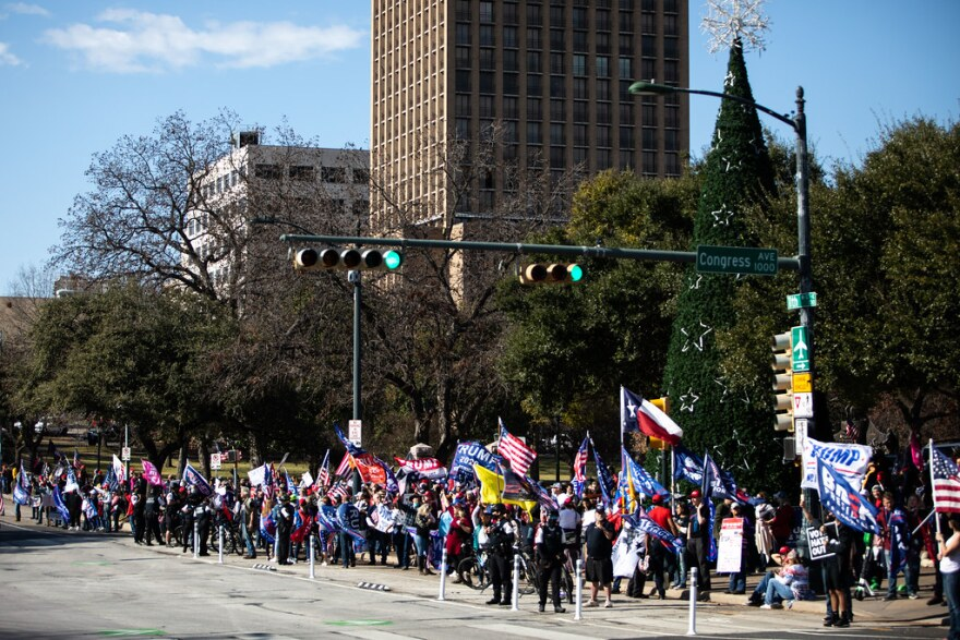 Supporters of President Trump gather in downtown Austin in front of the state Capitol on Wednesday to protest the Electoral College certification of President-elect Biden's victory.