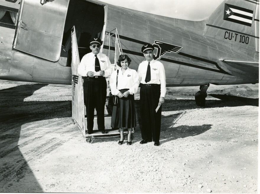 An Aerovias Q plane with crew at Key West Airport.