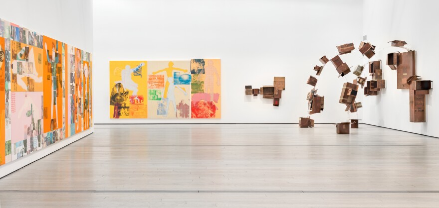 Cardboard boxes spring off the wall in Rauschenberg's <em>The 1/4 Mile.</em>