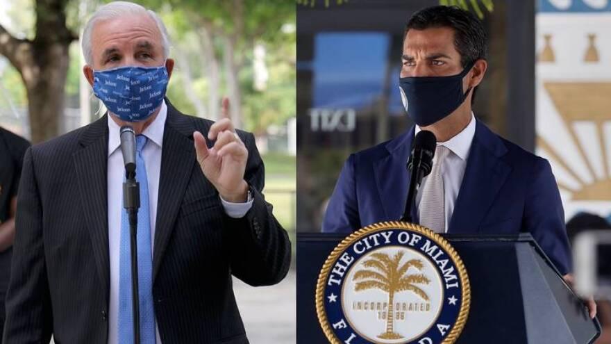 Miami-Dade County Mayor Carlos A. Gimenez and Miami Mayor Francis Suarez.