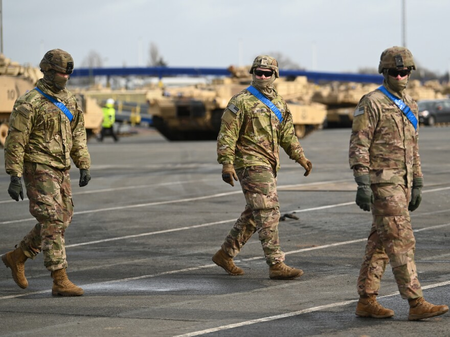 U.S. soldiers walk alongside tanks from the U.S. 2nd Brigade Combat Team, 3rd Infantry Division, parked at Germany's Bremerhaven port on Feb. 21. The U.S. could be considering drawing down a portion of its armed forces based in Germany.