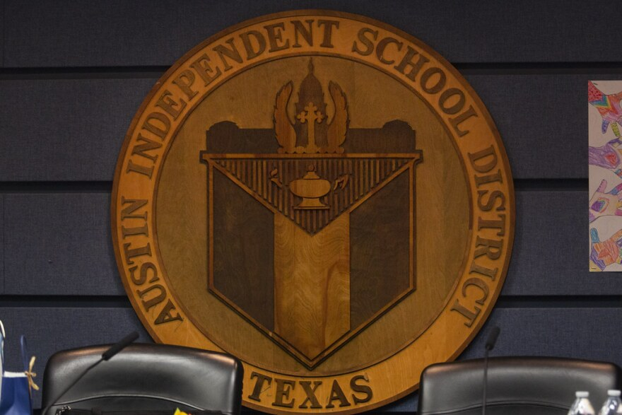 The seal that hangs in the Austin ISD board of trustees room