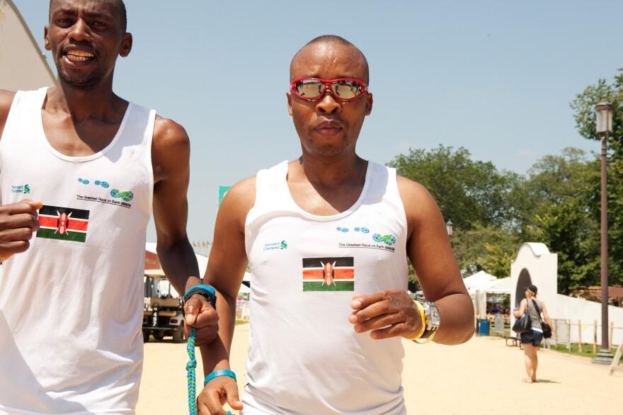 Joseph Kibunja guides blind runner Henry Wanyoike (in sunglasses).