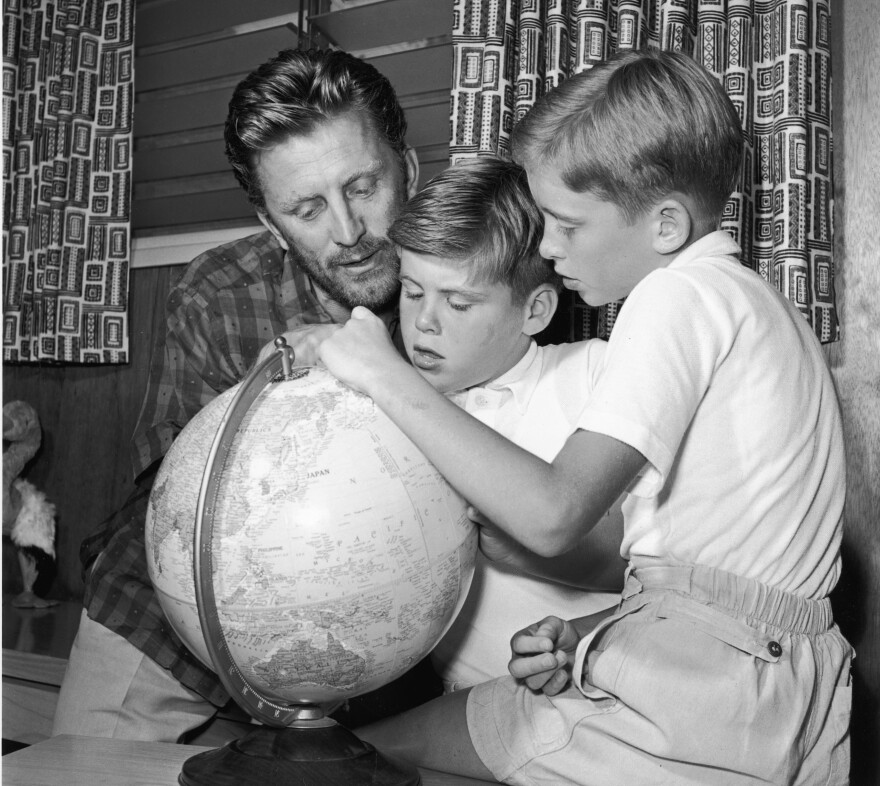 Douglas with his eldest sons, Joel (center) and Michael, circa 1956.
